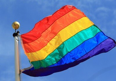 A rainbow flag is hoisted above City Hall in Oakland, Calif. on Tuesday, March 26, 2013. T